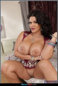 Busty Latina milf Angelina Castro spreading legs to show shaved cunt